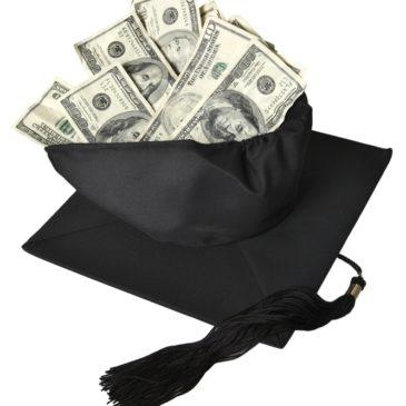 Black graduation cap filled with cash.
