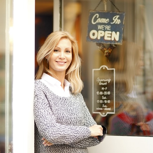Woman standing outside of business